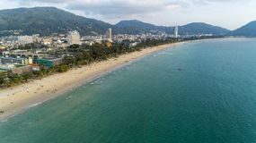 Beautiful wave crashing on sandy shore at patong beach in phuket thailand,aerial view drone shot stock image