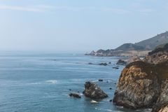 Beautiful waves crashing on the coast of Monterey, California stock photography