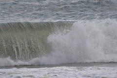 Beautiful waves crashing at the ocean beach royalty free stock photo