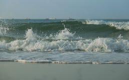 Beautiful waves of South China Sea on Dadonghai beach. Stock Photos