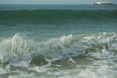 Beautiful waves of South China Sea on Dadonghai beach. Royalty Free Stock Photo