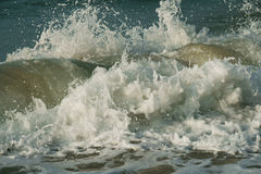 Beautiful waves of South China Sea on Dadonghai beach. Royalty Free Stock Images
