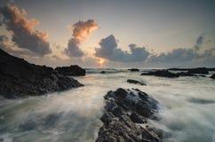 Beautiful waves splashing on unique rocks formation Royalty Free Stock Photo