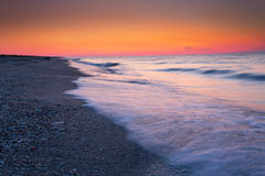 Beautiful waves on sunset over beach Stock Photo