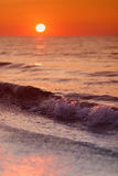 Beautiful waves on sunset over beach Stock Photography