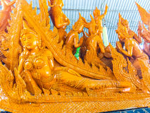 Beautiful wax candle crafted with Buddha and angels images at Ubon Ratchathani Province, Thailand stock image