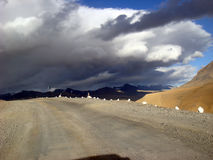 Beautiful weather on the way. Clouds almost came to mountain road royalty free stock photos