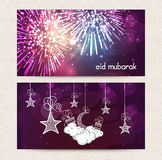 Beautiful web header or banner for Eid celebration. Beautiful fireworks, hanging moon and stars decorated web header or banner set for famous Islamic festival Royalty Free Stock Photos