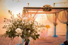 Beautiful wedding arch on the beach. In sunset background Stock Photo