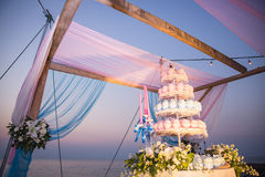 Beautiful wedding arch on the beach. In sunset time Royalty Free Stock Photography