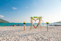Beautiful wedding arch floral decoration on the beach Royalty Free Stock Photos