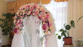 Beautiful wedding arch of flowers stock video