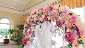 Beautiful wedding arch of flowers stock video footage
