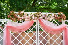 Beautiful wedding arch in the park for the ceremony Stock Photo