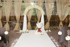 Beautiful wedding arch with roses in the restaurant Royalty Free Stock Photos