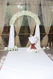 Beautiful wedding arch with roses in the restaurant Stock Image