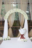 Beautiful wedding arch with roses in the restaurant Stock Images