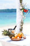 Beautiful wedding arch on tropical beach, focus on bottle Stock Photography
