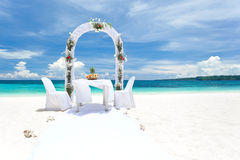 Beautiful wedding arch on tropical beach. Nobody. Travel wedding Royalty Free Stock Image