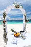 Beautiful wedding arch on tropical beach Stock Image