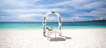 Beautiful wedding arch on tropical beach Stock Photography