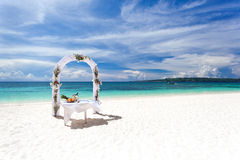 Beautiful wedding arch on tropical beach Royalty Free Stock Photos