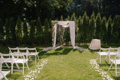 Beautiful wedding archway. Arch decorated with biege cloth and flowers Stock Images