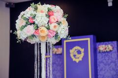 Beautiful wedding arrangement- Wedding decoration in pink color. Beautiful flowers, decor and candle on wedding party. Christian w Stock Photography