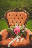 Beautiful wedding boho bouquet. On an antique armchair Stock Image
