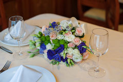 Beautiful wedding boquet lying on table in restaurant.  Stock Photo