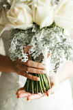 Beautiful wedding bouqet in hands Stock Photos