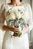 Beautiful wedding bouqet in hands. Of bride Royalty Free Stock Photography