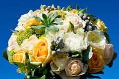 Beautiful wedding bouquet. With roses in different colors against a blue sky Stock Photography