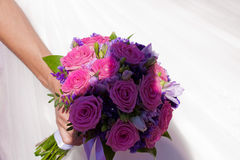 Beautiful wedding bouquet. On a background of white wedding dresses Stock Photos