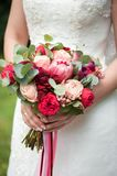 the bride holds a beautiful wedding bouquet stock photos