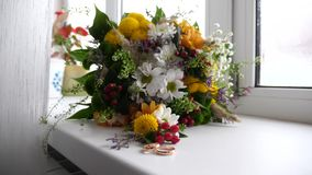 Beautiful wedding bouquet for bride lies on window sill in early morning. Romantic flowers as gift. Floristry.  stock video