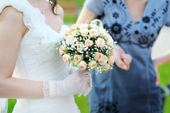 Beautiful wedding bouquet in bride's hand Royalty Free Stock Photos