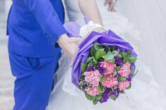 Beautiful wedding bouquet in bride`s hand stock photography