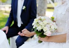 Beautiful wedding bouquet in the bride's hands Royalty Free Stock Images