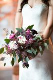 Wedding bouquet in bride`s hands Royalty Free Stock Photo