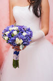Beautiful wedding bouquet in bride's hands. Royalty Free Stock Image