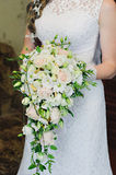 Beautiful wedding bouquet in bride's hands.Wedding flowers. Stock Photo