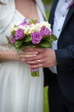 Beautiful wedding bouquet in brides and grooms hands Stock Photo