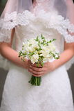 Beautiful wedding bouquet close-up. Beautiful wedding bouquet in bride hands Royalty Free Stock Image