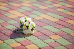 Beautiful wedding bouquet on colorful paving stones Stock Photography