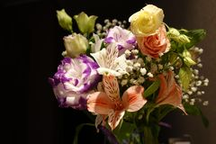 Beautiful wedding bouquet composed of different flowers on a black background.  stock photography