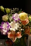 Beautiful wedding bouquet composed of different flowers on a black background.  royalty free stock photo