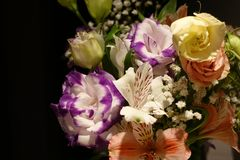 Beautiful wedding bouquet composed of different flowers on a black background.  stock photo