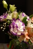 Beautiful wedding bouquet composed of different flowers on a black background.  stock images