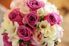 Beautiful wedding bouquet with cyclamen, pink and ivory flowers. Wedding bouquet with delicate roses and freesias to accompany the bride. Elegant arrangement in Royalty Free Stock Images